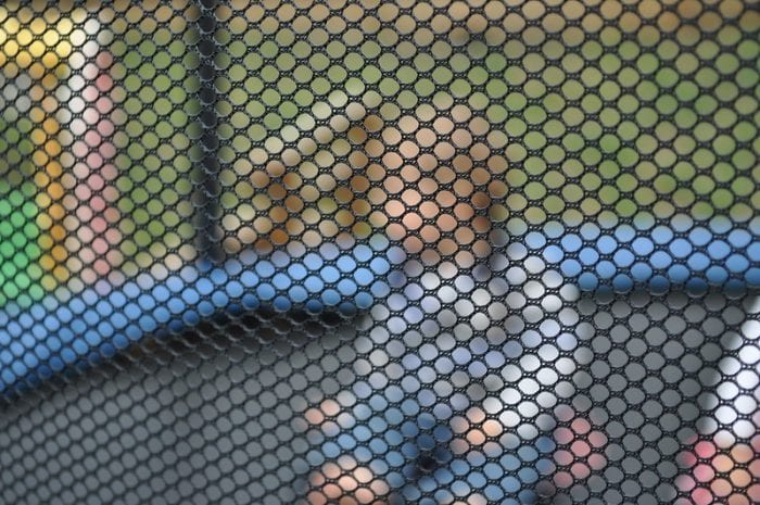 Trampoline with net for safety purposes