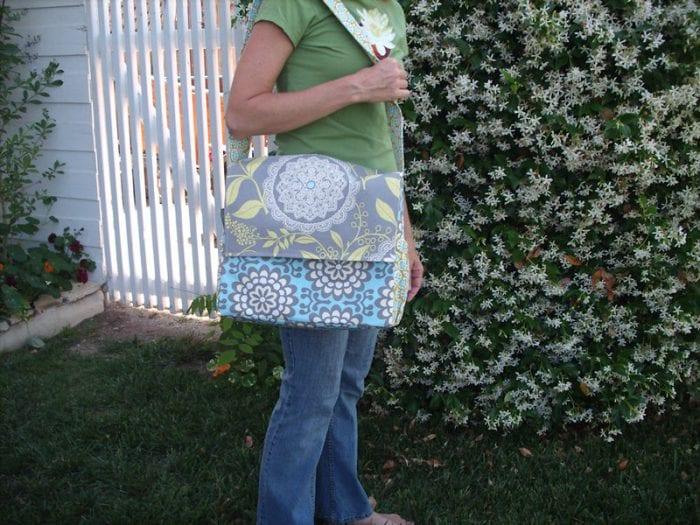 Mom's diaper bag in messenger type style.