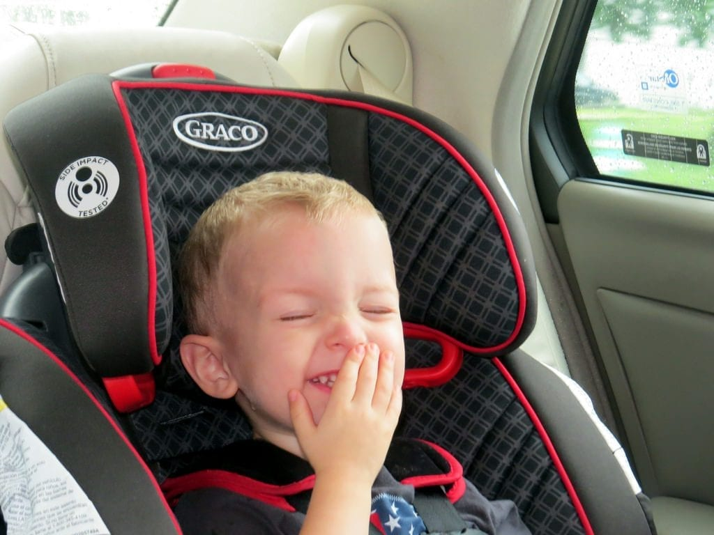 Toddler seating on a Graco car seat.