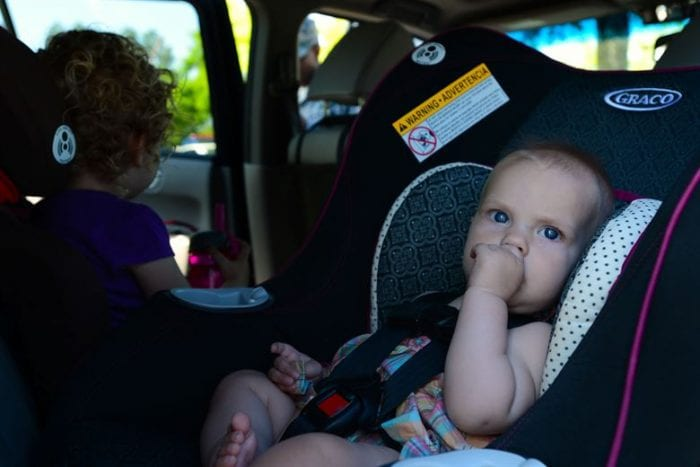 Baby looks comfortable seating on a Graco Car Seat