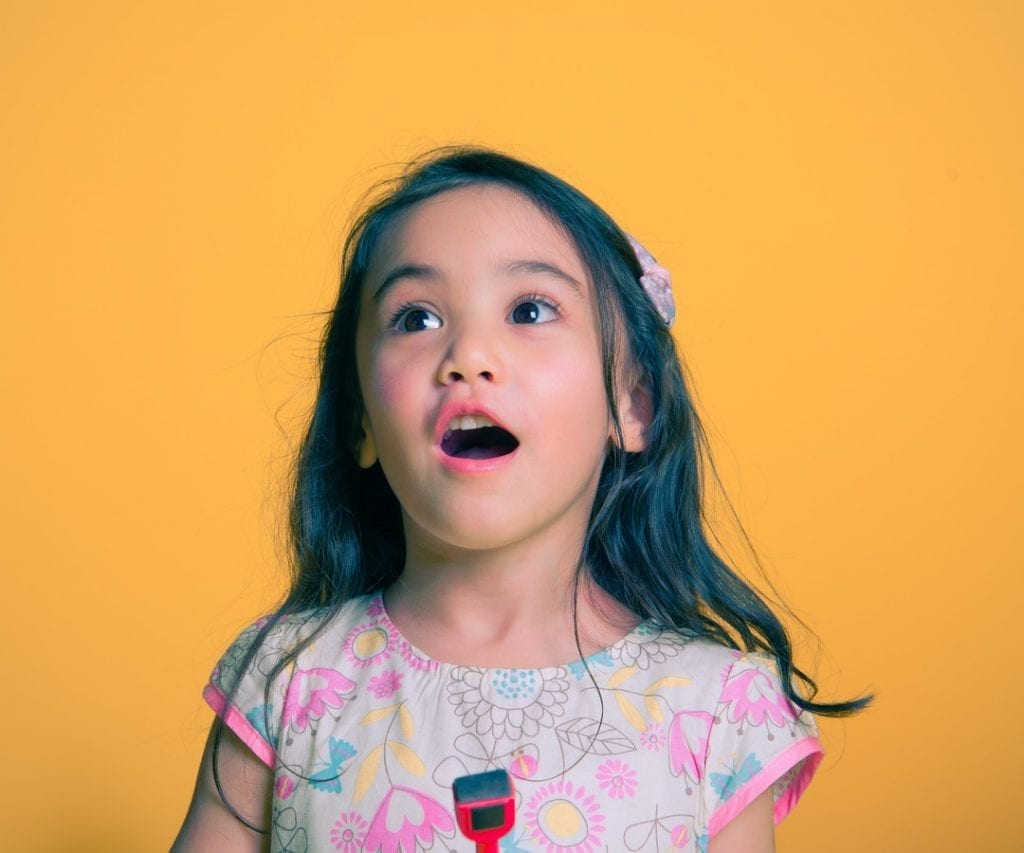 Kid singing a song. What could the best microphone for her?