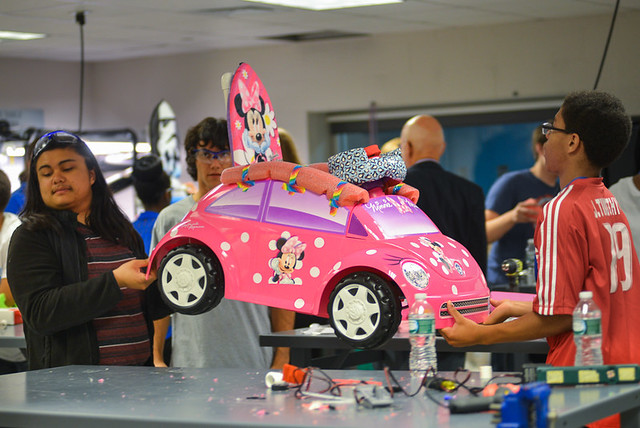 Some kids preferred a ride on car like this Minnie Mouse version. While other kids preferred minnie's happy helpers singing or bowtique cash register or minnie mouse mini necklace activity.