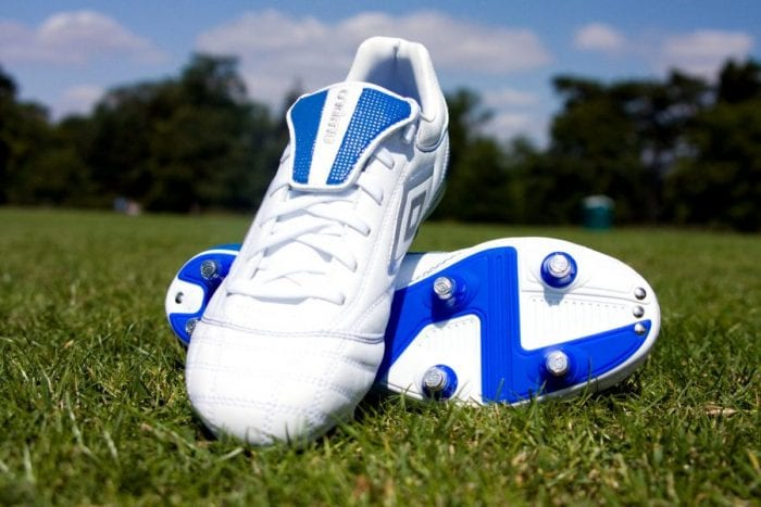 White and blue youth football cleats