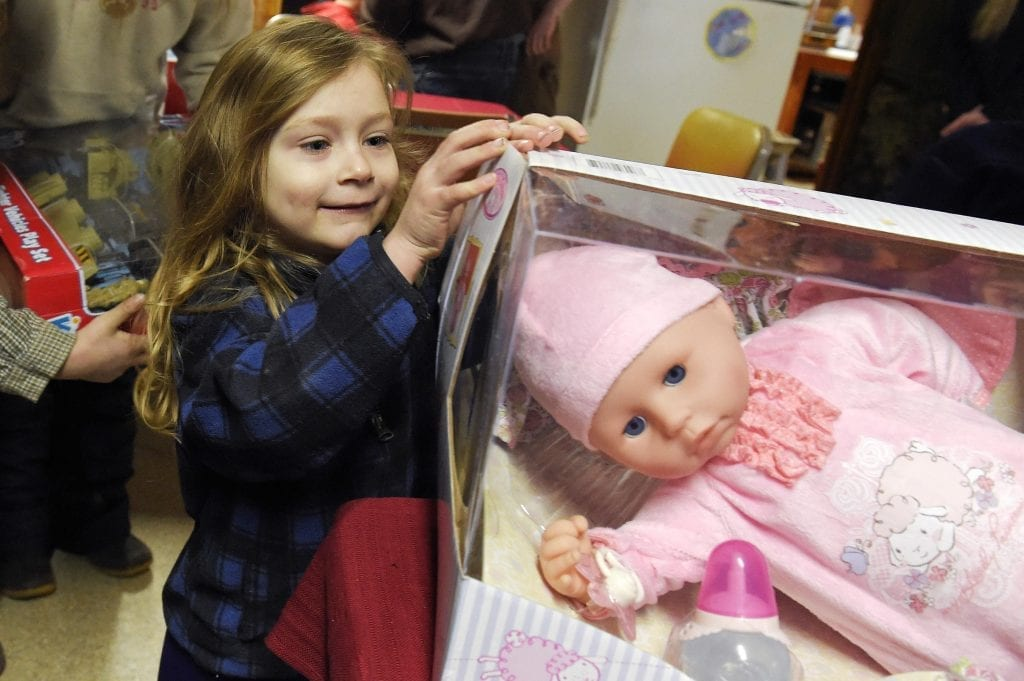 The kid looks interested with the baby doll. Buy your kid a good baby doll that will last for years.