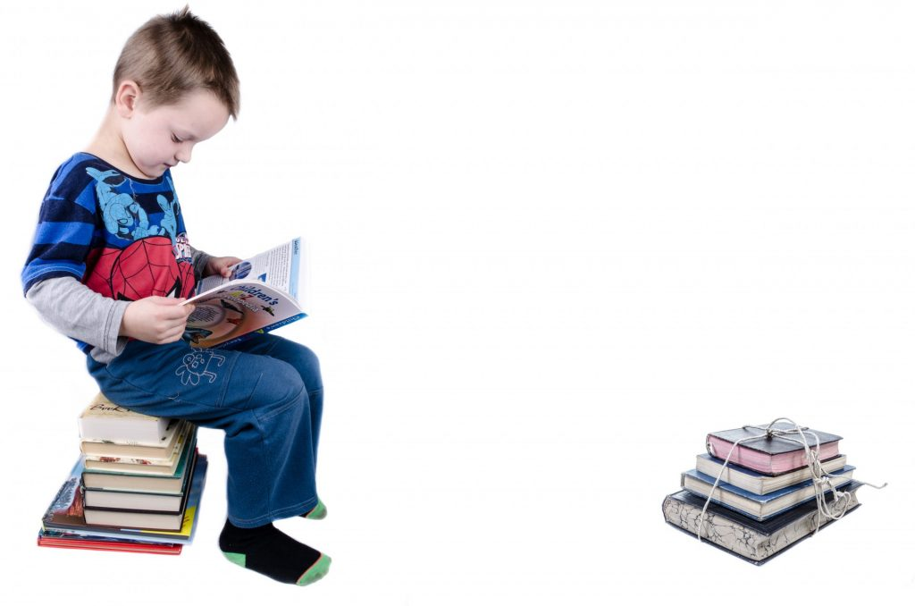 a 5 year old boy reading books