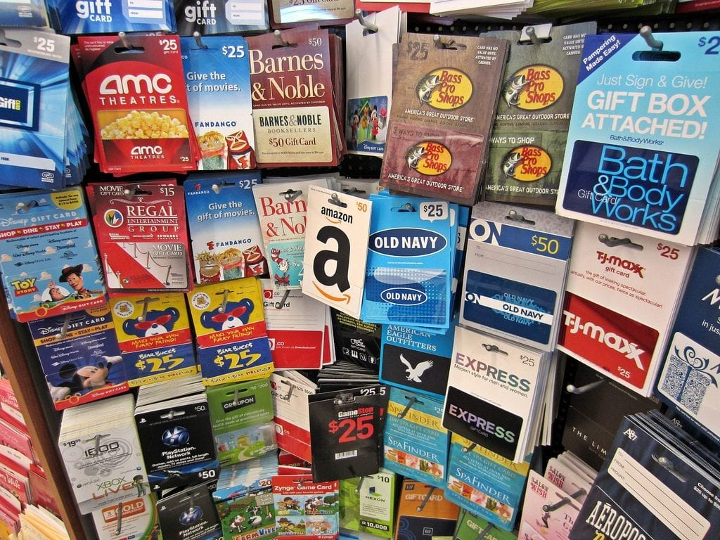 11 year old boys would be happy to receive gift cards. He can pick the toy of his choice with gift card.