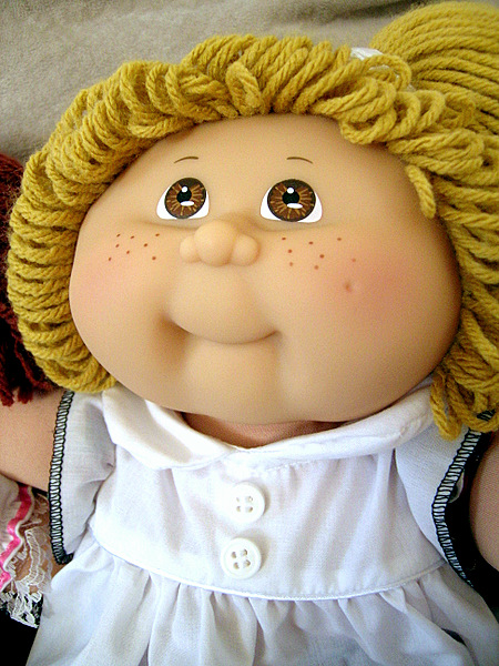 Cabbage Patch Kids Doll with hair made of yarn, cute and chubby cheeks. This good baby doll is great for 1 year old and up.