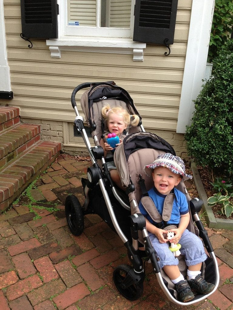 Double Stroller with 2 kids. This type of double stroller is portable and saves up space.