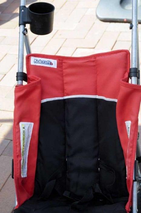 A red and black Kolcraft stroller. Kolcraft Cloud Sport is a Lightweight Stroller and safe for kids.