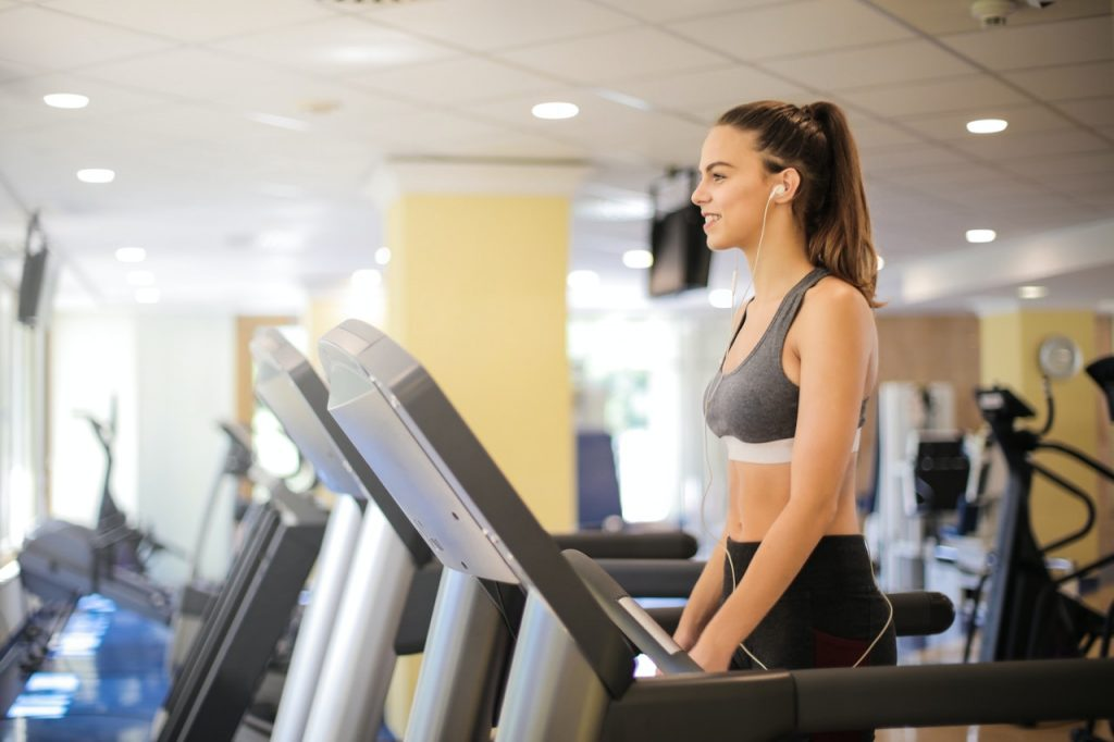A woman keeping a fit and healthy body by doing treadmill exercise.
