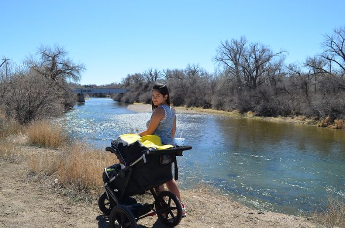 A Mother using an urbini stroller for her baby. Find out if Urbini is the best brand of stroller.