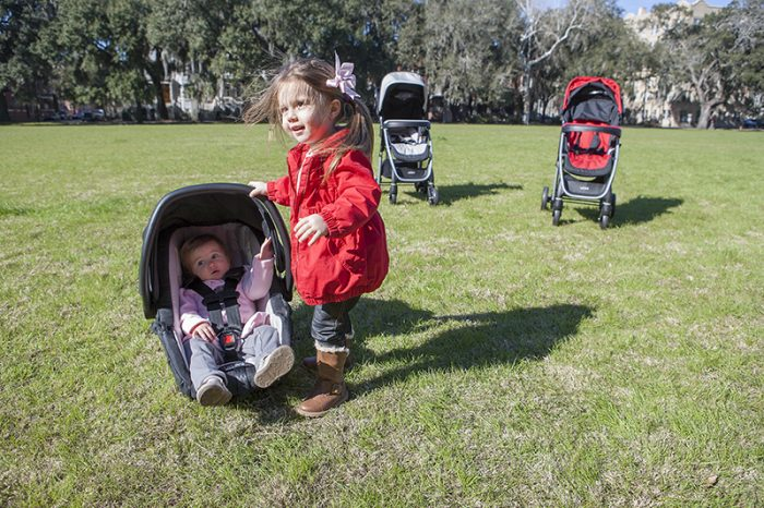 Baby on the Urbini car seat and Urbini strollers at the back. Learn more about the Urbini stroller and car seat travel sytem.