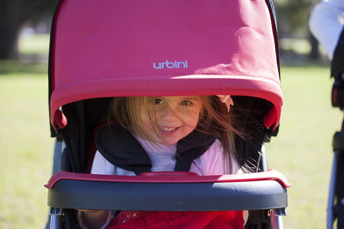 A girl on her Urbini Stroller. This Urbini stroller is lightweight and easy to carry. Check more about the urbini stroller features here.
